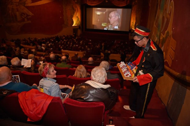 Bobbie Preston, of Moraga, sits with her husband Tom Preston as they order a box of candy from employee Thomas Do while attending the Orinda Theatre 75th anniversary gala celebration in Orinda, Calif., on Thursday, Dec. 29, 2016. The 800-seat art deco theater was built between 1937-1941 by local developer Donald Rheem. (Jose Carlos Fajardo/Bay Area News Group)
