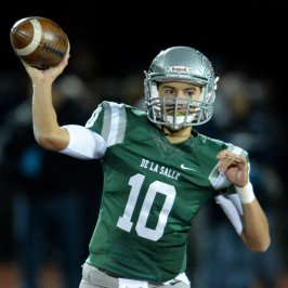 De La Salle High quarterback Abel Ordaz (10) passes for a first down in the first quarter of their North Coast Section Open Division playoff game against Freedom High in Dublin, Calif., on Friday, Dec. 2, 2016. (Doug Duran/Bay Area News Group)