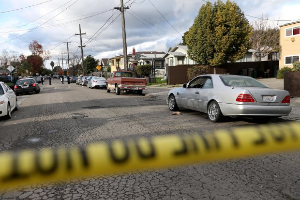Oakland police investigate the scene of a homicide in the 9300 block of Sunnyside Street in Oakland, Calif., on Thursday, Jan. 12, 2017. Two people were shot at about 1:22 p.m., and one later died. (Jane Tyska/Bay Area News Group)