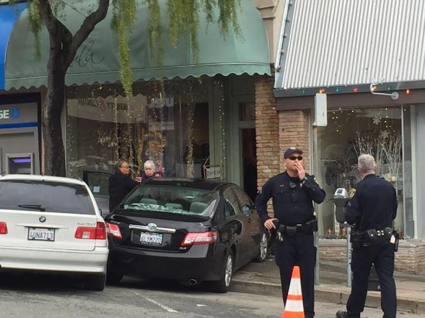 Oakland police at the scene where a car crashed into a shop Monday morning on La Salle Avenue. (Ginny Prior/Staff0