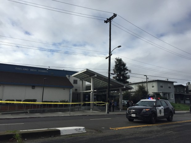 Oakland police investigate a shooting that occurred Thursday morning outside Oakland High School. (George Kelly/Bay Area News Group)