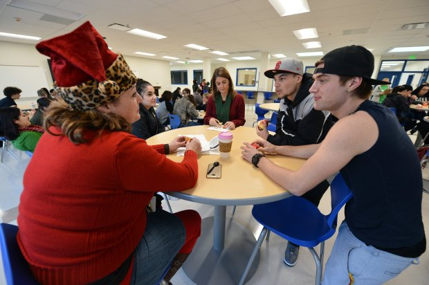 From left, Melissa Boyd, who teaches history and art, senior Bri Beacham, Paula Marchese-Caccamo, who teaches English, senior Blaze McEvoy and senior Austin McCarthy hang out in a common room at the new Vicente-Martinez High School and Briones School campus in Martinez, Calif., on Thursday, Dec. 22, 2016. (Kristopher Skinner/Bay Area News Group)