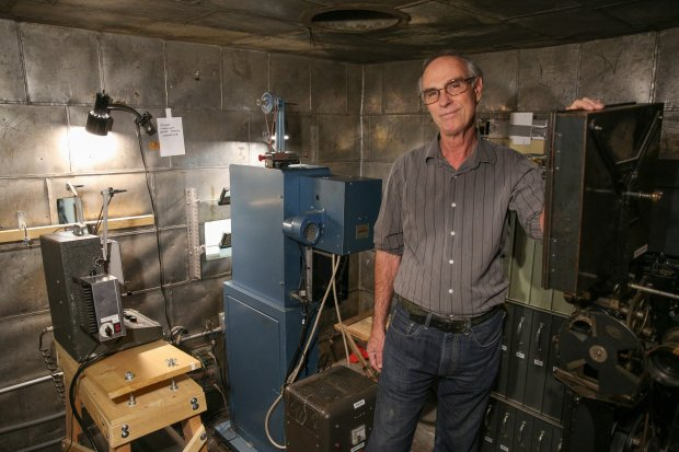 David Kiehn, the founder of the Niles Essanay Silent Film Museum, poses fora photo in the tin-lined film projection booth in the Edison Theater, tucked away in the back of the museum. The museum shows silent films on weekends, including feature length films and comedy shorts with live piano accompaniment. Photo by Joseph Geha.