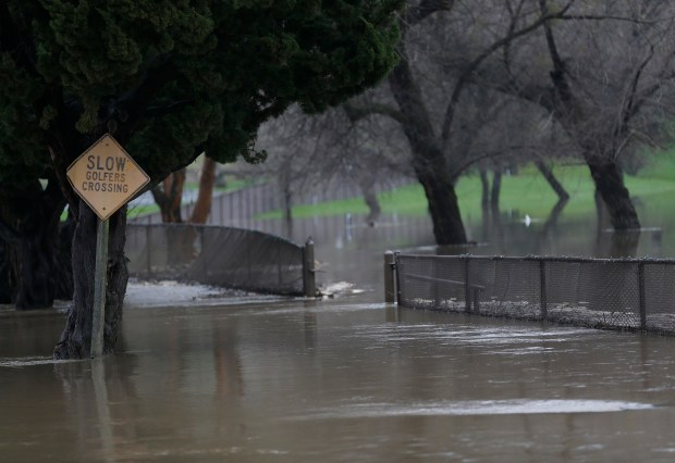 Flood waters are seen at the Redwood Canyon Golf Course in unincorporated Castro Valley, Calif., on Tuesday, Feb. 7, 2017. Twenty-two people were evacuated from a luncheon at the golf course restaurant as water from San Leandro Creek crossed the parking lot road.(Jane Tyska/Bay Area News Group)