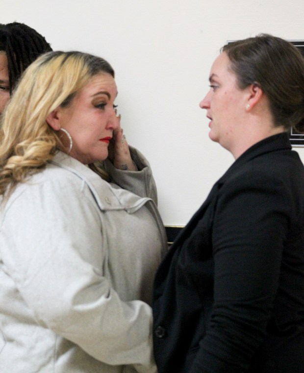 Angel Parker, left, the mother of William Sampson is comforted by best friend Tiffany Jones during a break in the vehicular manslaughter trial of Melissa Ho at the Rene C. Davidson Courthouse in Oakland, Calif., on Feb. 1, 2017. Ho is accused of striking and killing Sampson on the shoulder of Interstate 880, in Fremont, on Aug. 16, 2014. (Anda Chu/Bay Area News Group)