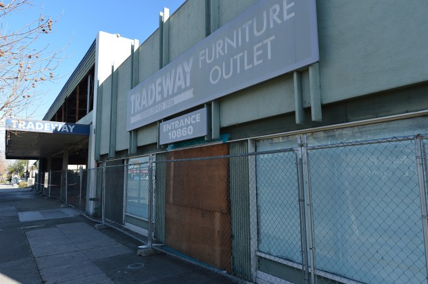 Demolition of the former Tradeway Furniture store is underway on San Pablo Ave. in El Cerrito, Calif., on Tuesday, Feb. 14, 2017. The site will be home to the Hana Gardens mixed-use project. (Kristopher Skinner/Bay Area News Group)