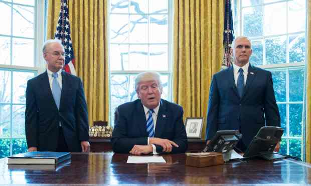 US President Donald Trump, with Vice President Mike Pence (R) and Health and Human Services Secretary Tom Price (L), pauses as he speaks from the Oval Office of the White House in Washington, DC, on March 24, 2017.Trump on Friday asked US Speaker of the House Paul Ryan to withdraw the embattled Republican health care bill, moments before a vote, signaling a major political defeat for the US president. / AFP PHOTO / MANDEL NGANMANDEL NGAN/AFP/Getty Images