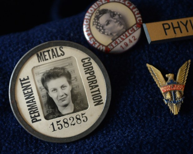 Phyllis Gould, 95, one of the original Rosie the Riveter welders during WWII, wears her shipyard ID at home in Fairfax, Calif. on Friday, March 3, 2017. She has lobbied for a Rosie the Riveter national day. (Alan Dep/Marin Independent Journal)