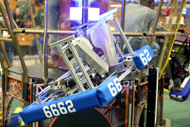 Team E.W.A.'s (Engineers With Attitude) robot from College Park High School successfully climbs a rope while competing in a match at the FIRST (For Inspiration and Recognition of Science and Technology) robotics competition held at St. Ignatius College Preparatory in San Francisco, Calif., on Saturday, March 18, 2017. Some 40 high school teams competed in the robotics competition that builds science, engineering, and technology skills. (Anda Chu/Bay Area News Group)