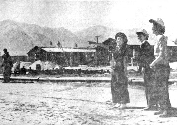 BERKELEY HISTORICAL SOCIETYThis staged photo of happy Japanese-Americans arriving the Manzanar concentration camp ran in the March 24, 1942 Berkeley Daily Gazette, without showing bayonets or barbed fire.