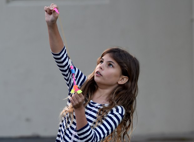 Alexa Niejadlik, 10, launches a flying device she earned after participating in a science fair at Glorietta Elementary School in Orinda, Calif., on Wednesday, March 22, 2017. (Susan Tripp Pollard/Bay Area News Group)