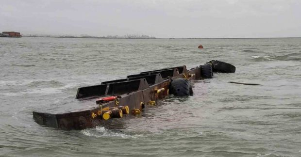 A barge before it sank below the waters of San Francisco Bay on Friday. (U.S. Coast Guard)