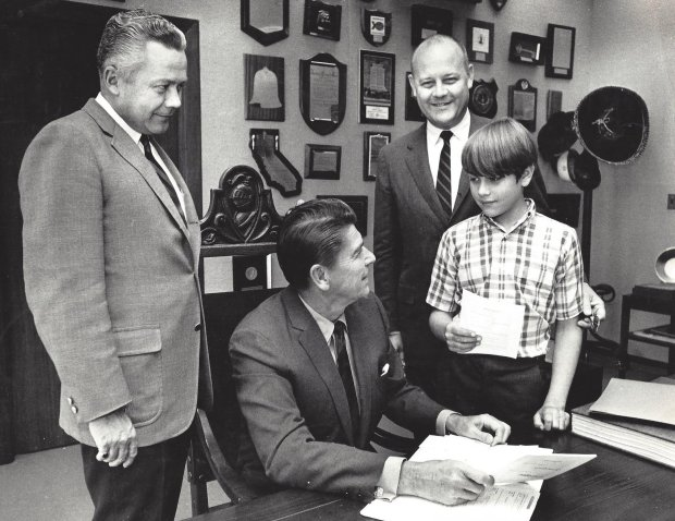Gov. Ronald Reagan signs the California Environmental Quality Act in 1970 with Assemblyman John T. Knox, D-Richmond, second from right, and son John H. Knox. At left is Knox's friend, Republican Senator Bob Beverly. (Courtesy of John H. Knox)