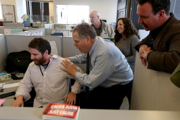 East Bay Times reporters Matthias Gafni, Thomas Peele, Harry Harris, Erin Baldassari and David DeBolt react as they learn of their Pulitzer Prize win for breaking news at their office in downtown Oakland, Calif., on Monday, April 10, 2017. The staff of the East Bay Times won journalism's highest honor for their coverage of the tragic Ghost Ship warehouse fire which killed 36 people in December 2016. (Jane Tyska/Bay Area News Group)