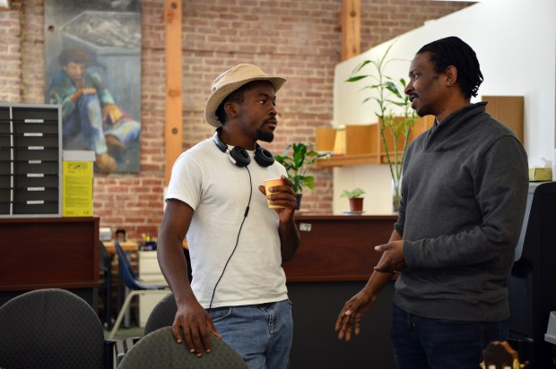 Brandon Greene, staff attorney with the East Bay Community Law Center, right, talks with Joshua (no last name provided) about his legal situation in Berkeley, Calif. on Wednesday, May 17, 2017. The East Bay Community Law Center is working to help people deal with court-imposed civil assessment fees that they say target the poor. (Kristopher Skinner/Bay Area News Group)