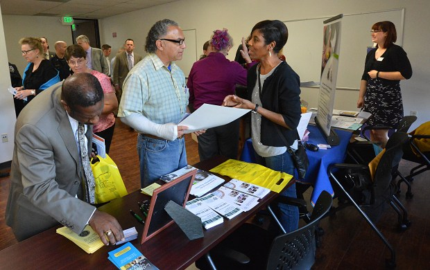 Gilbert Herrera, center, of Concord, visits with Dorea Stevens, right, of the Bay Area Crisis Nursery during the open house for the new Central Family Justice Center in Concord, Calif., on Thursday, March 19, 2015. (Dan Rosenstrauch/Bay Area News Group)