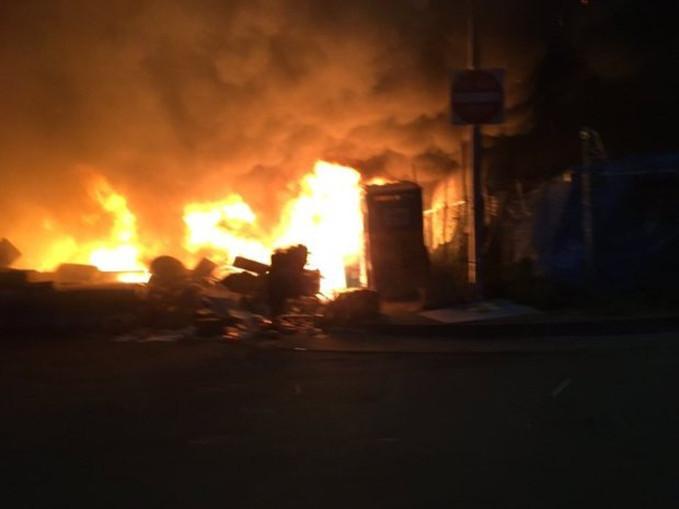 Flames attack tents and structures in a homeless encampment Monday, May 1, 2017 in the 3500 block of Peralta Street in West Oakland.