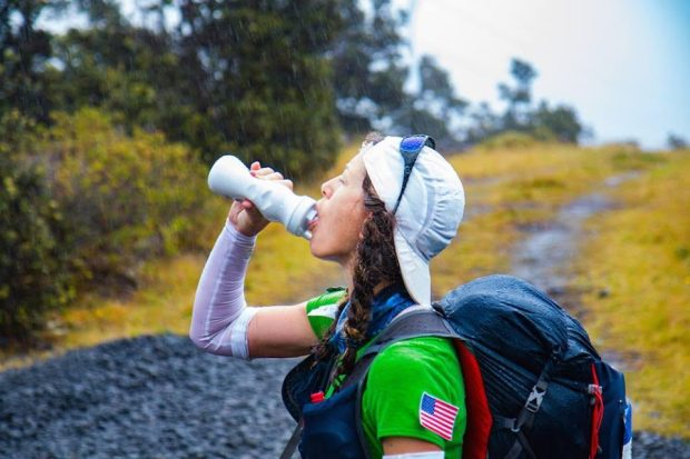 Sarah Lavender Smith is shown midway last week through the second stage of the Mauna to Mauna Ultra, a six-stage, 153-mile ultramarathon in Hawaii. It rained excessively during Stages 1 through 3. (Mauna to Mauna Ultra)