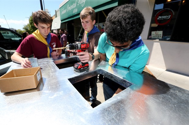 Rowen Halpern, left, Emmet Hegarty and Mitchell Celaya from the Berkeley's Boy Scout Troop 6, work on one of the trash boxes as part of a new parklet on Solano Avenue in Berkeley, Calif., Saturday, May 13, 2017. The parklet is being built by the boys scouts under the direction of Eagle Scout candidate Hegarty. (Ray Chavez/Bay Area News Group)