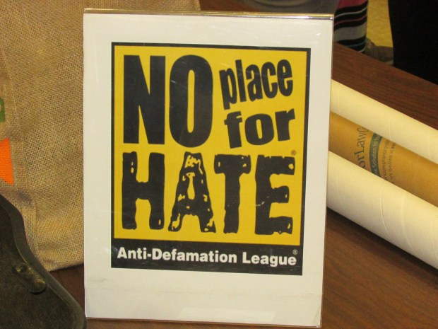 The Anti-Defamation League tracks anti-Semitic speech and other hateful rhetoric. This sign was at a May 31 forum at Edison Elementary School in Alameda. (David Boitano/For Bay Area News Group)
