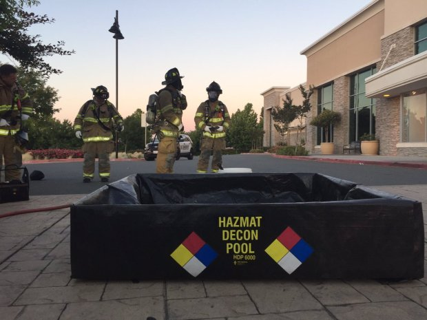 Contra Costa County Fire Protection District firefighters shared this image Tuesday, June 13, 2017 of firefighters waiting near a decontamination pool outside JC Penney, 4951 Slatten Ranch Road, in Antioch after a hazardous-materials report.