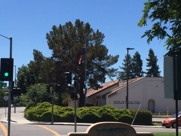 The American flag was flown upside down, seen here outside the Pleasanton post office.
