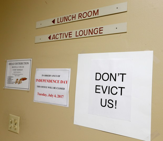 """A sign reading """"Don't Evict Us!"""" is taped to the wall of the Open House Senior Center on Thursday, June 15, 2017, in El Cerrito, Calif. The senior center is facing possible relocation from its current location at 6500 Stockton Avenue. (Aric Crabb/Bay Area News Group)"""