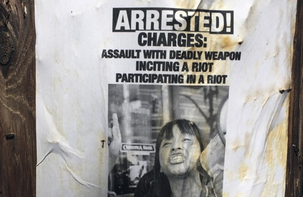 """On a residential street near Martin Luther King Jr. Middle School in Berkeley on Thursday, a flier with a picture of King school teacher Yvonne Felarca and the title """"Arrested!"""" was affixed to a utility pole. (Tom Lochner/Staff)"""