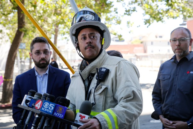Interim Fire Chief Darin White updates the media on the four-alarm fire that destroyed a large apartment building under construction on Valdez Street in Oakland, Calif., on Friday, July 7, 2017. No injuries have been reported; however, nearby apartments were evacuated. (Laura A. Oda/Bay Area News Group)