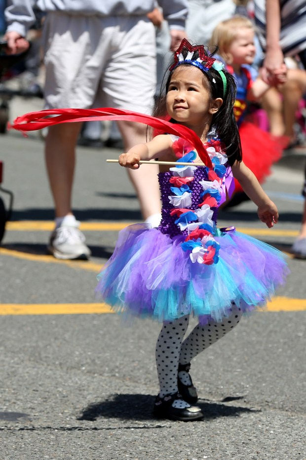 Sophie Nguyen, 3, takes part in the 4th of July Parade along Highland Avenue in Piedmont. (Ray Chavez/Bay Area News Group)