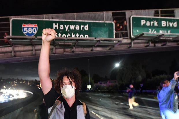 Protesters block both directions of the Interstate 580 freeway during a rally against racism in Oakland, California on August 12, 2017. Protesters marched on the streets of Oakland in response to a series of violent clashes that erupted at a white-nationalist rally in Charlottesville, Virginia earlier in the day that left at least one dead and dozens injured. (Josh Edelson/AFP/Getty Images)