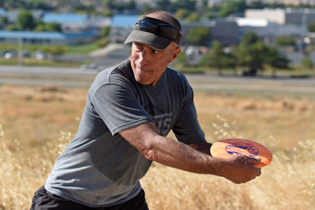 Bob Lambrose, of Antioch, prepares to throw a disc while playing a round of disc golf at the newly built course in Antioch, Calif., on Monday, Aug. 28, 2017. (Jose Carlos Fajardo/Bay Area News Group)