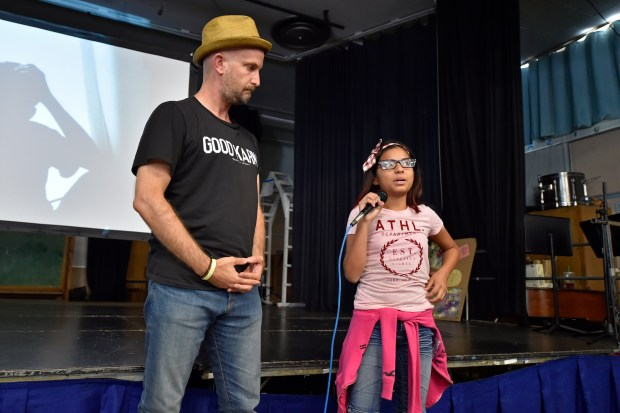Leon Logothetis, author of The Kindness Diaries, listens to seventh grader Dayis Sanchez speak about a time when someone was not kind to her while at Sequoia Middle School in Pleasant Hill, Calif., on Thursday, Aug. 31, 2017. Logothetis spoke to students about how to incorporate a culture of kindness into their daily lives. Logothetis also stars in a Netflix show called The Kindness Diaries. (Jose Carlos Fajardo/Bay Area News Group)