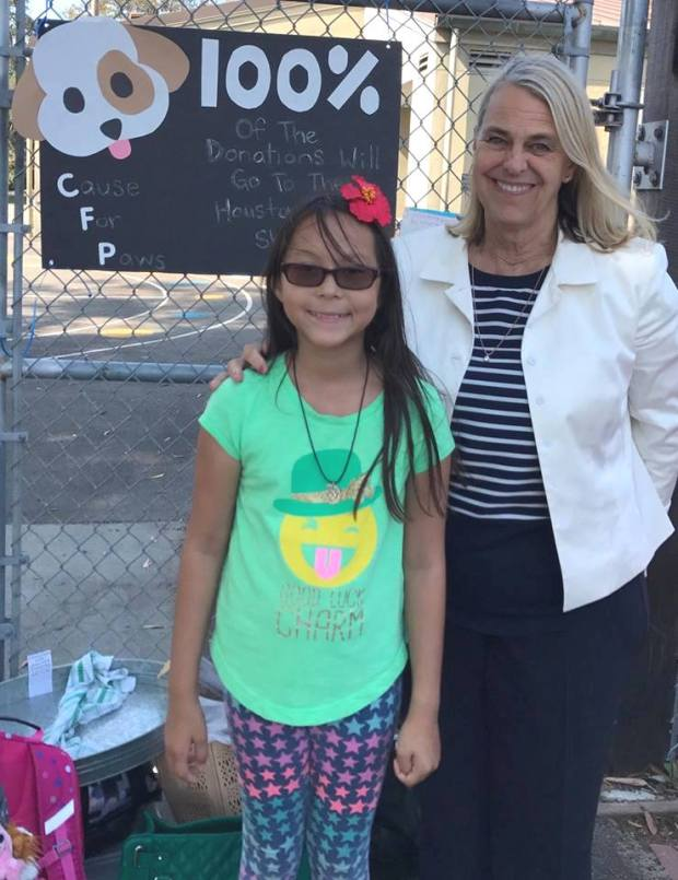 Earhart student Mikayla Melero stands with Earhart Principal Joy Dean during her bake sale on Sept. 8. Mikayla was raising money to help both wild and domestic animals affected by Hurricane Harvey. (Courtesy of Lori Melero)