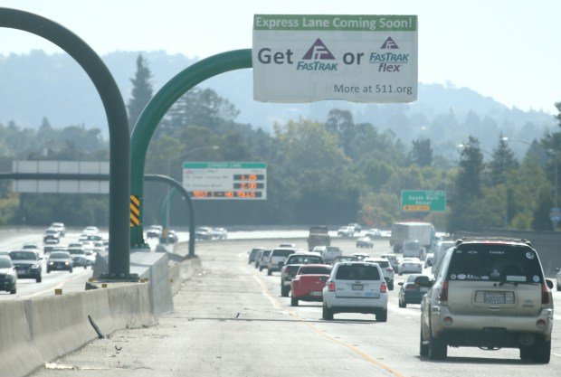 A sign announcing an express lane coming to Interstate 680 is photographed along the southbound lanes before the South Main Street off-ramp in Walnut Creek, Calif., on Friday, Sept. 29, 2017. The lane will be open Monday, Oct. 9 to solo drivers willing to pay the toll. (Anda Chu/Bay Area News Group)