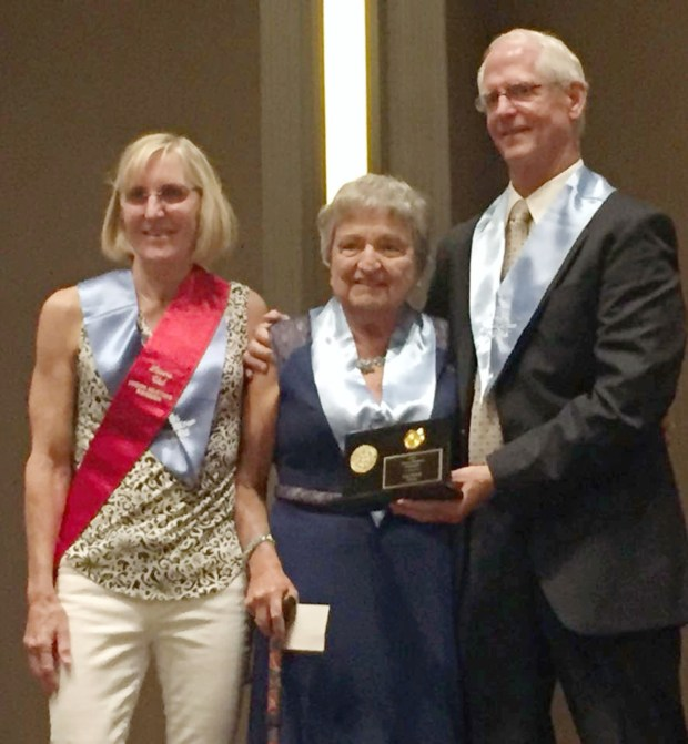 Rossmoor resident Ann Hirsch, center, was recently inducted into the International Hall of Fame by Laura Val (left), a prior inductee, and Tom Boak, master of ceremonies.