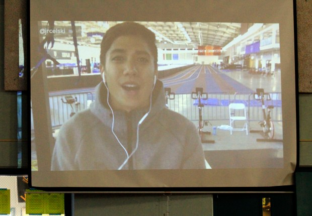 A video is played revealing the Classroom Champions mentor, three-time speed skating Olympic medalist and short track world record holder J.R. Celski, in the gym at Oak Grove Middle School in Concord, Calif., during a welcome rally on Friday, Sept. 22, 2017. Mt. Diablo Unified School District has partnered with Classroom Champions an international non-profit that pairs teachers with Olympians and Paralympians to be mentors using video lessons, live video chats and social media to encourage them to recognize their potential, set goals and dream big. (Laura A. Oda/Bay Area News Group)