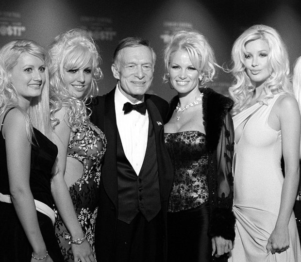 Hugh Hefner, 75, center, poses with four of his girlfriends before the start of The New York Friars Club Roast in New York, Sept. 29, 2001. The New York Friars, a members-only group of entertainers who've poked fun at each other at formal dinners for nearly a century, turned their barbs on the Playboy magazine founder, who was an easy target for his libido and his luxurious lifestyle. A severely edited version of the star-studded, black-tie event is scheduled to air at 10 p.m. EST Sunday on Comedy Central. (AP Photo/Jim Cooper)