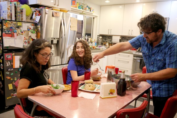 Alameda High sophomore Natasha Waldorf, center, with her parents Mel, left, and Jessica converse while having dinner at their home in Alameda, Calif., on Friday, Oct. 27, 2017. The Jewish family say their daughter was harassed for her Jewish heritage by a german exchange student and she has been the victim of an ongoing campaign of Anti-Semitism. (Ray Chavez/Bay Area News Group)