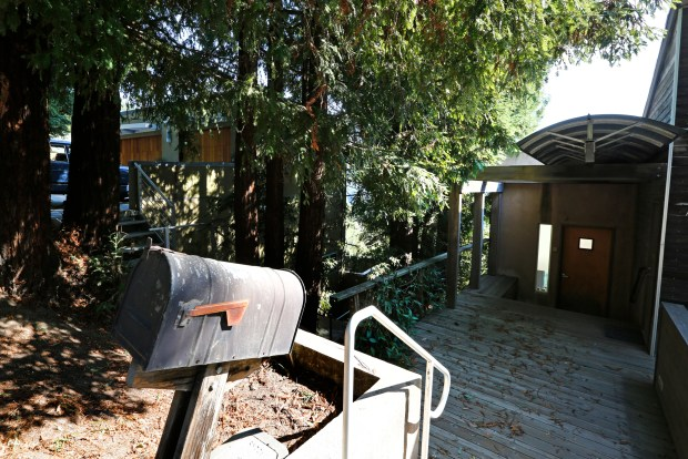 Untrimmed redwood trees grow in between two homes not allowing the required ten foot defensible space required by the city's vegetation management requirements in the Oakland Hills on Wednesday, Oct. 18, 2017. The 26th anniversary of the Oakland Hills fire is on Oct. (Laura A. Oda/Bay Area News Group