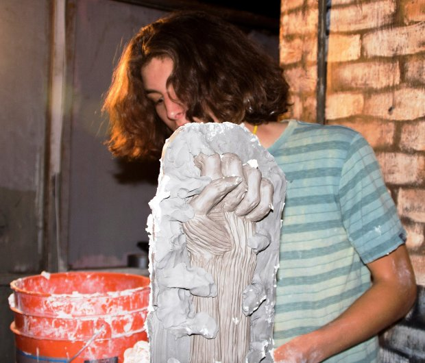 Karen Lee ThompsonKai Girard sculpts a piece for the elaborate Albany Haunt attraction that has become a favorite beyond Albany's borders.