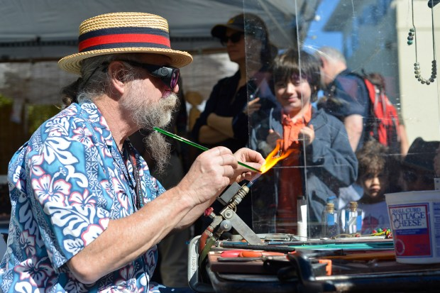 Ralph McCaskey works on a glass sculpture at the 8th annual East Bay Mini Maker Faire in Oakland, Calif., on Sunday, Oct. 22, 2017.