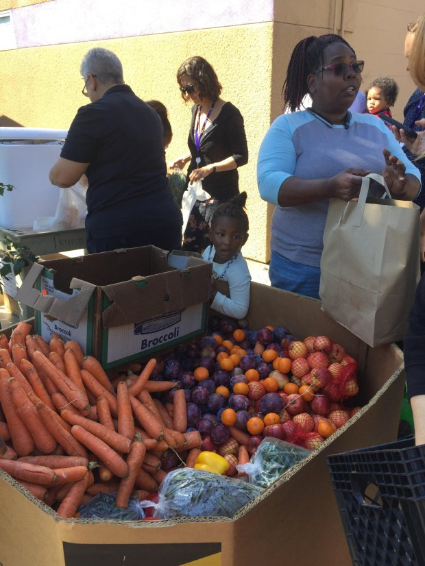 "East Oakland resident Sherrie Lowe, on the right, picks up produce at oneof UCSF Benioff Children's Hospital's ""Food Farmacy"" markets. (Photo courtesy of UCSF Benioff Children's Hospital)"