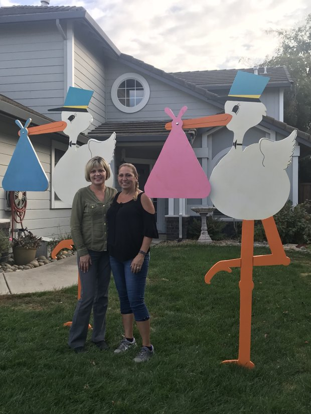 Oakley native Dannielle Hilt and her sister, Kelly Martin, right, stand bystork signs, which they make and deliver in their new business venture called Storks R Us. COURTESY PAULA KING