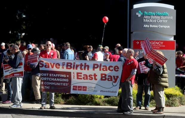 Community members protest in front of Alta Bates Summit Medical Center on Sunday, Nov. 5, 2017, in Berkeley, Calif. Sutter Health plans to move acute care services from the Berkeley hospital to a new medical center in Oakland. (Aric Crabb/Bay Area News Group)