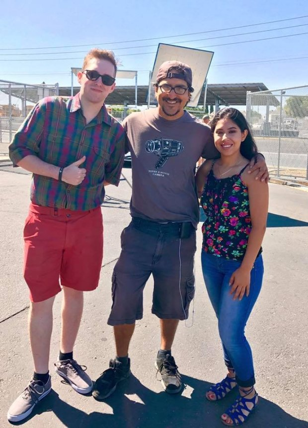 """Antioch High alum Konner Heredia (Class of 2012) and Ana Murillo (2017)took a quick photo with director Jose Montesinos during the filming of """"Psycho Brother In Law"""" in late July. The crew filmed for three days at various locations at Antioch High School, including the baseball fields, career center, the small gym and several class hallways. The movie was recently shown on Lifetime Movies network. Courtesy Antioch High"""
