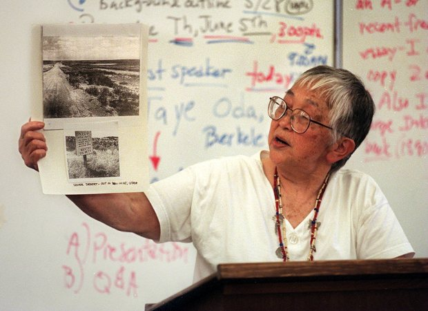 Tayeko Oda holds an article with photos of the Topaz, Utah, internment camp where her family lived during World War II during a survivor, holds some photo of the internment camp during a May 13, 1997, speech to a class at California High School in San Ramon. (Doug Duran/Staff archives)