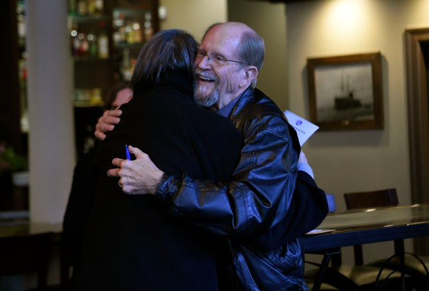 Jim Franz is greeted by well-wishers at his retirement party at The Star on Park in downtown Alameda, Calif., on Wednesday, Jan. 11, 2018. Franz, a longtime City of Alameda employee, musician and a man who was a Freedom Marcher in Selma, Alabama during the early 60's is retiring on January 18. (Dan Honda/Bay Area News Group)