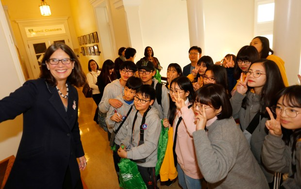 Alameda Mayor Trish Spencer takes a selfie with the group of South Korean students at City Hall in Alameda, Calif., on Monday, Jan. 22, 2018. Twenty middle school age students from the Yeongdong area of South Korean, Alameda's sister city, got a tour of City Hall, the Police Department and the Fire Department in Alameda. (Laura A. Oda/Bay Area News Group)