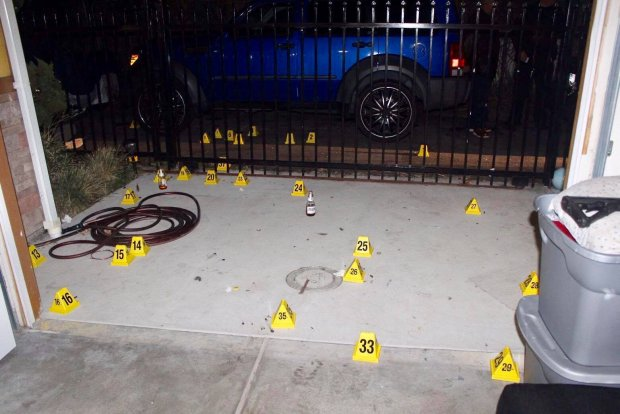 Richmond police shared this image Tuesday, Jan. 2, 2018 of expended bullet markers in a home driveway late Sunday, Dec. 31, 2017 after officers responded to reports of apparent celebratory gunfire.